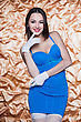 Portrait Of Young Smiling Woman Posing In Blue Dress And White Gloves stock photo