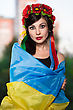Portrait Of Young Woman Posing Wrapped In Ukrainian Flag stock photo