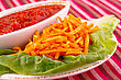 Potato Chips, Red Sauce And Lettuce Leaf Isolated On Colorful Tablecloth stock image