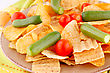 Potato Chips And Vegetables On Plate And Kitchen Towel stock photo
