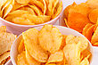 Potato And Wheat Chips In Bowls On Gray Background stock photography