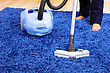 Powelful Vacuum Cleaner In Action-a Men Cleaner A Carpet