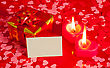 Present And Two Heart Shaped Candles With Blank Card stock image