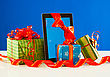 Presents With A Tablet Pc Against Blue Background stock photography