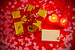 Presents And Two Heart Shaped Candles With Blank Card On Red Background stock photo