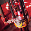 Pressure Piston Splattered In Red & Yellow Paint stock photo