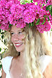 Pretty Blond Girl With Pink Flowers On Her Head stock photo