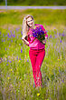 Pretty Blond Woman Posing In The Field With Flowers