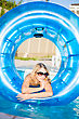 Pretty Blond Woman Posing With Rubber Ring In Swimming Pool stock photography