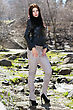 Pretty Brunette In Black Jacket And Light Pants Posing Outdoors