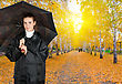 Pretty Brunette Girl At Black Coat Under Umbrella stock image