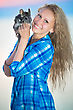 Pretty Cheerful Blond Woman Posing With Chinchilla stock photography