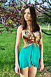 Pretty Slim Lady Dressed In Sexy Golden And Turquoise Dress stock photography