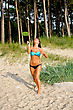 Pretty Woman Playing Badminton On The Beach stock image