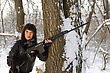 Pretty Young Woman With A Sniper Rifle Near The Tree