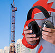 Protective Headphone At Man Hands On Building Background stock image