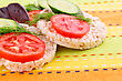 Puffed Rice Crackers Sandwiches With Vegetables On Tablecloth stock photo