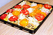 Raw Chiken On Baking Tray With Tomato And Potato stock image
