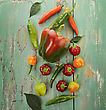 Raw Colorful Peppers On Rusty Wood stock photography