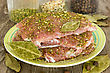 Raw Pork With Spices In A Plate On Wooden Background stock photo