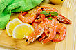 Raw Shrimp With Lemon, Basil And Green Cloth On A Wooden Board stock image
