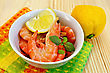 Raw Shrimp In A White Bowl With Lemon, Basil And A Napkin On A Wooden Board stock image