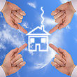 Real Estate Concept. Four Hands Around New House stock photography