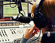 Rear View Of Female Dj Working In Front Of A Microphone On The Radio stock photography