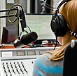 Rear View Of Female Dj Working In Front Of A Microphone On The Radio stock image