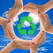 Recycle Symbol In A Circle Of Hands stock photography
