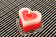Red Candle On Wooden Math. stock photo