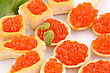 Red Caviar In Pastries And Lettuce On Plate stock photography