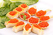 Red Caviar In Pastries And Lettuce On Plate stock photo