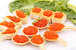 Premium Red Caviar In Pastries And Lettuce On Plate stock image