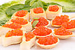 Red Caviar In Pastries And Lettuce On Plate stock image