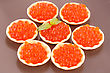 Red Caviar In Round Pastries On Brown Plate