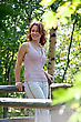 Red-haired Adult Woman In Forest Near Sea stock photography
