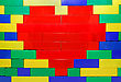 Red Heart Shape Of Lego Blocks On The Lego Wall stock image