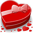 Red Heart-shaped Box Decorated With A Bow