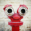 Red Old Fire Hydrant On A Street, Looking Like A Face. Instagram Style stock photo