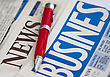 Red pen on the business newspaper stock photography