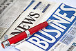 Red pen on the business newspaper stock image