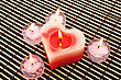 Red And Pink Candles On Wooden Math. stock image