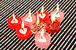 Red And Pink Candles On Wooden Math.