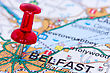 Red Pushpin On The Northern Ireland Map Showing Belfast Location stock photography