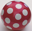 Red Rubber Ball & White Dots stock photography