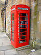 The red telephone box, a public telephone kiosk designed by Sir Giles Gilbert Scott, is a familiar sight on the streets of the United Kingdom, Malta and Gibraltar, and despite a reduction in their num stock image
