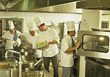 Restaurant Chefs, Cook Looking Into Oven stock image