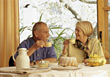 People Eating  Retired Couple Having Coffee and Cake stock photo