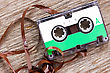 Retro Audio Cassette With Pulled Out Tape On The Wood Background stock image